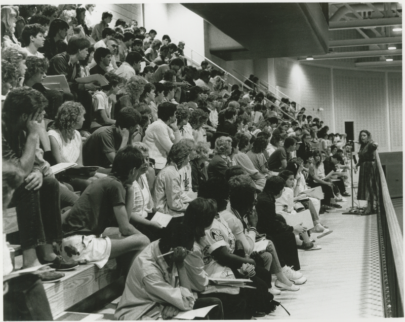 Go to Students sitting in bleachers listening to a speaker item page
