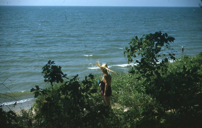 Go to Woman in tall grass near beach item page