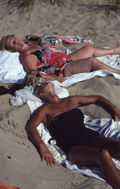 Go to Women sunbathing on the beach item page