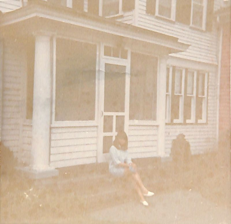 Go to Hazy view of a young woman seated on porch steps item page