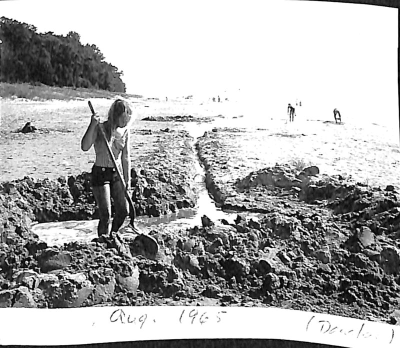 Go to Woman digging on a beach, August 1962 item page