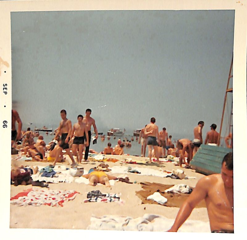 Go to Crowded beach with boats in the distance item page