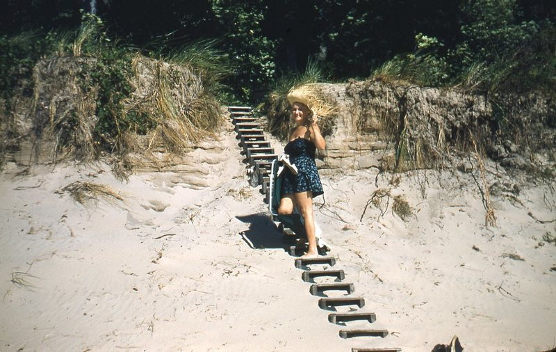 Go to Woman climbing dune steps item page