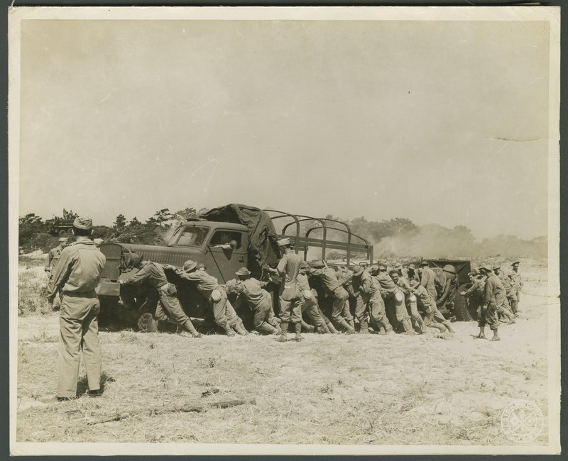 Go to Soldiers pushing heavy equipment during practice drills item page