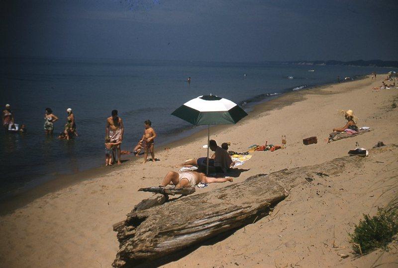 Go to Man under umbrella on beach item page