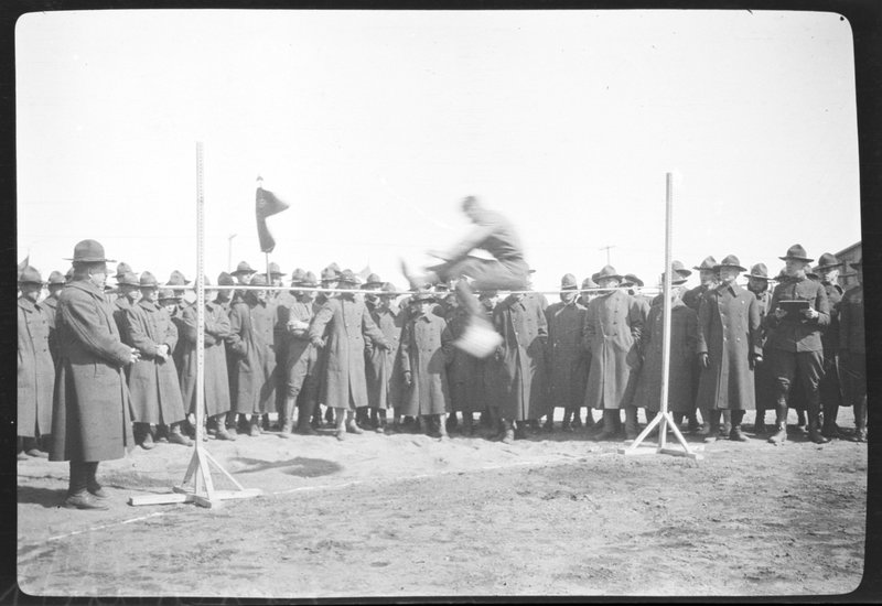 Soldiers watching high jump at Camp Custer, Michigan