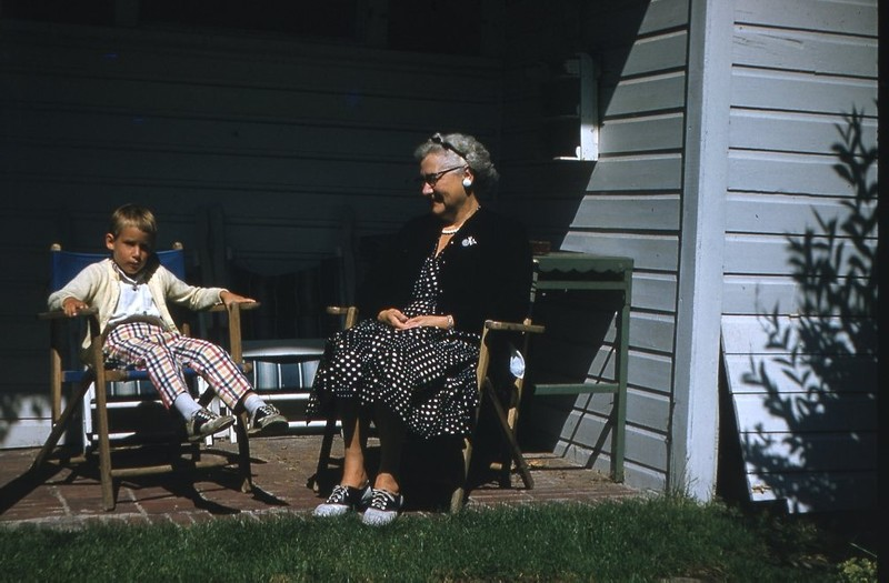 Go to Elderly woman and child sitting in lawn chairs item page