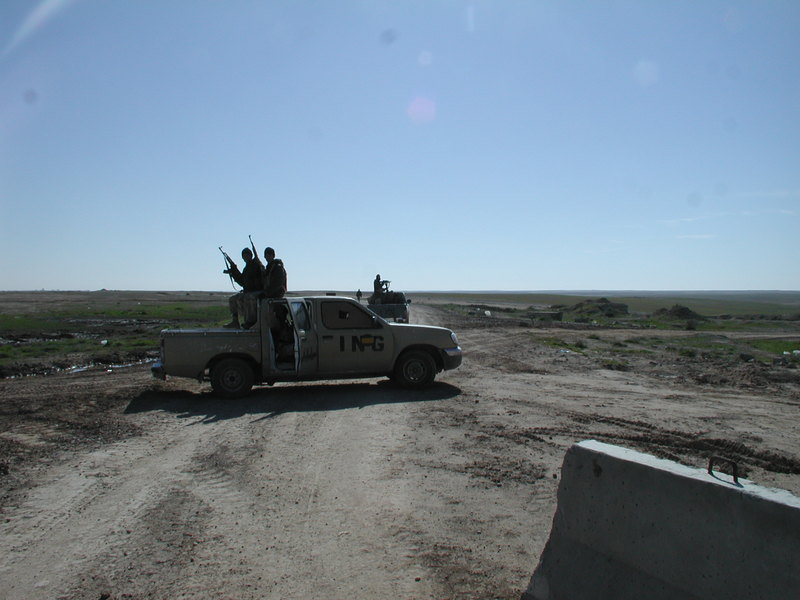Go to Iraqi guards at the rear gate of FOB Q-West looking south item page