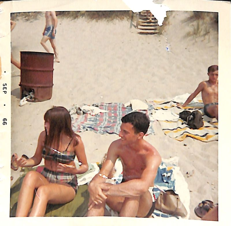 Go to Young couple smiling on the beach item page