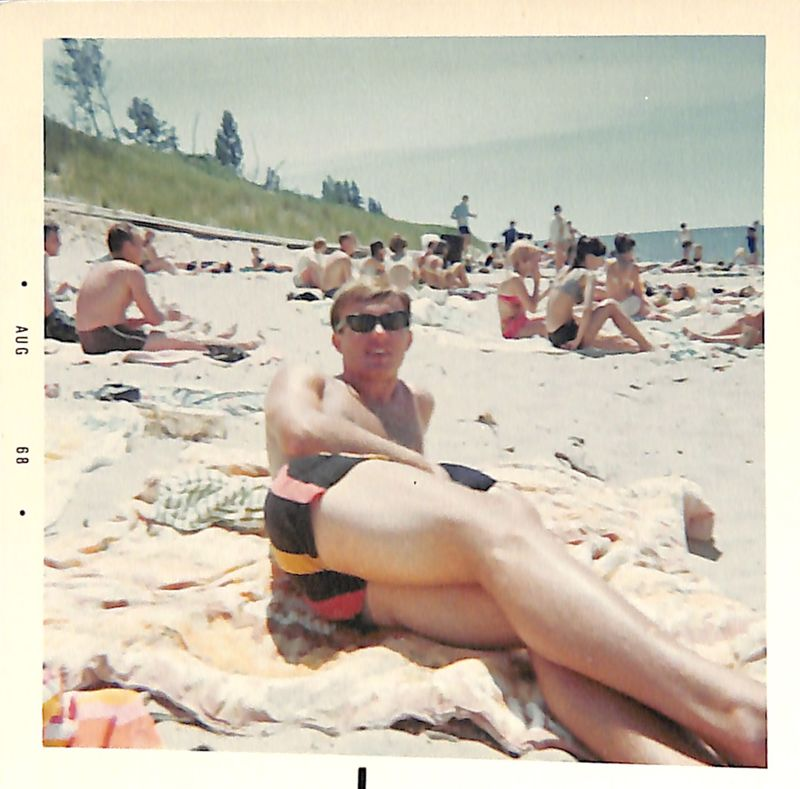 Go to Young man lying on the beach item page