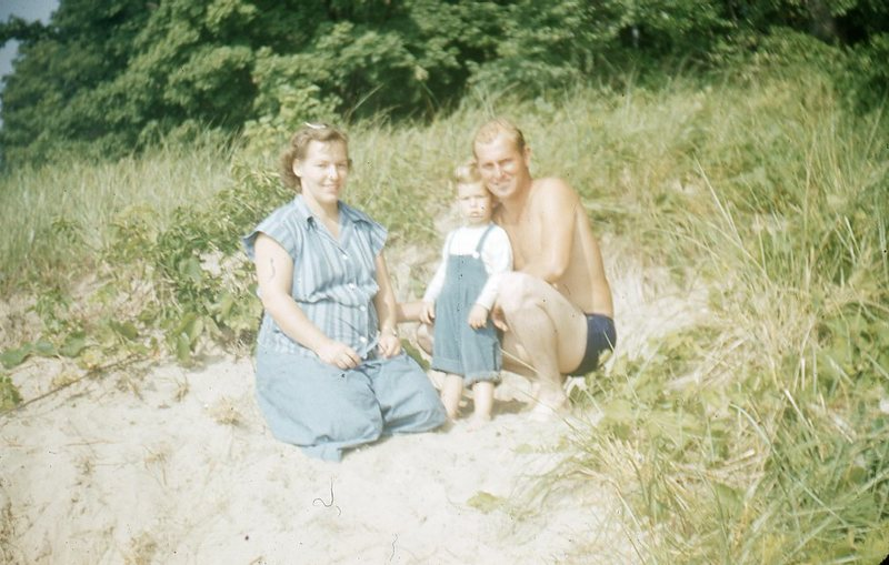 Go to Family of three on a sand dune item page