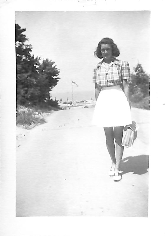 Go to Young woman standing on a road leading to Lake Michigan item page