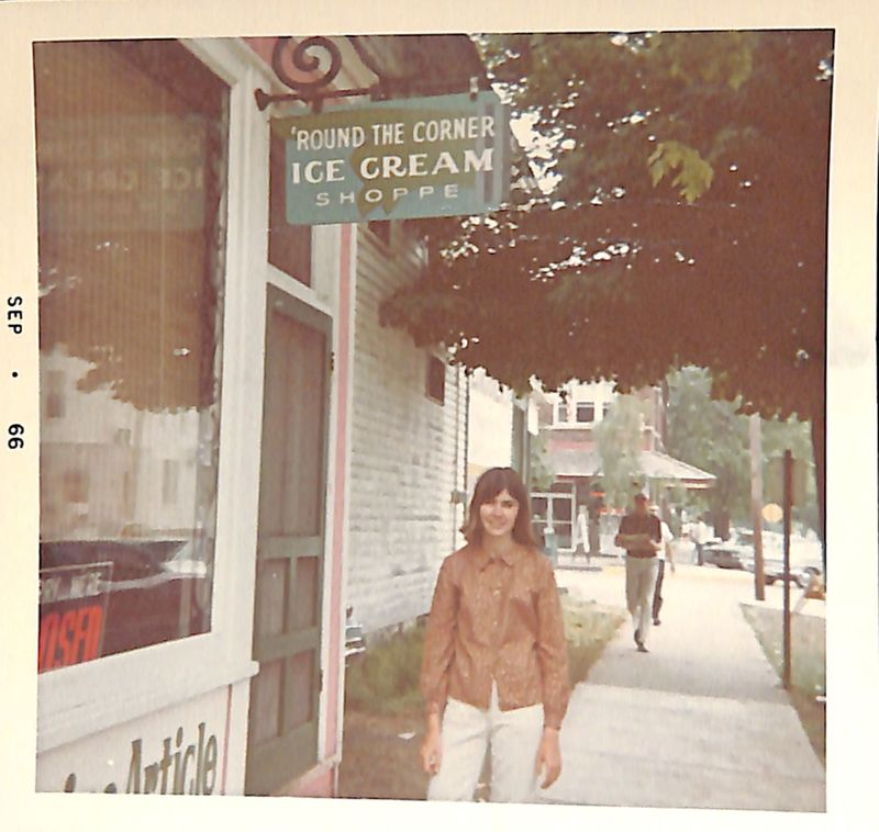 Go to Young woman standing in front of 'Round the Corner Ice Cream Shoppe item page