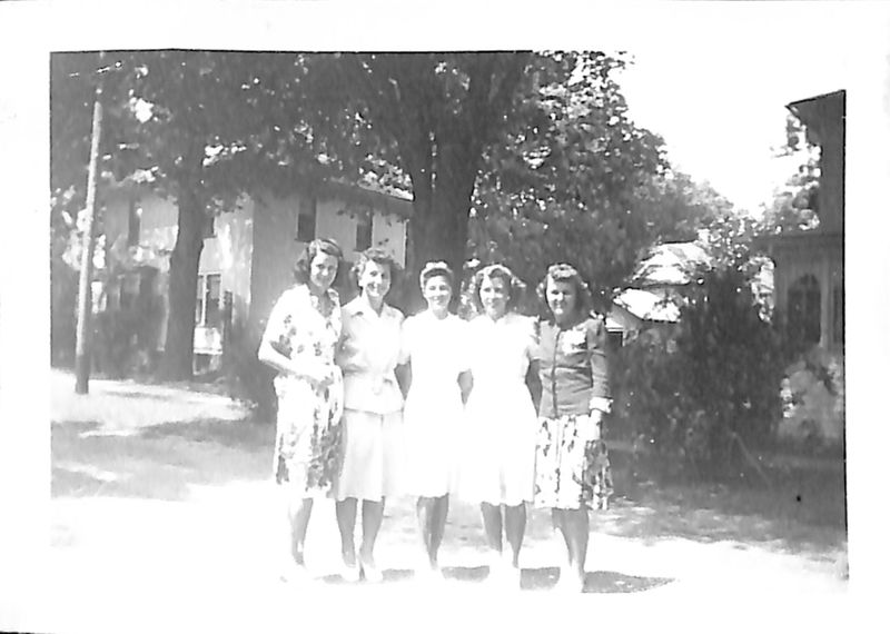 Go to Group of five women standing arm in arm item page