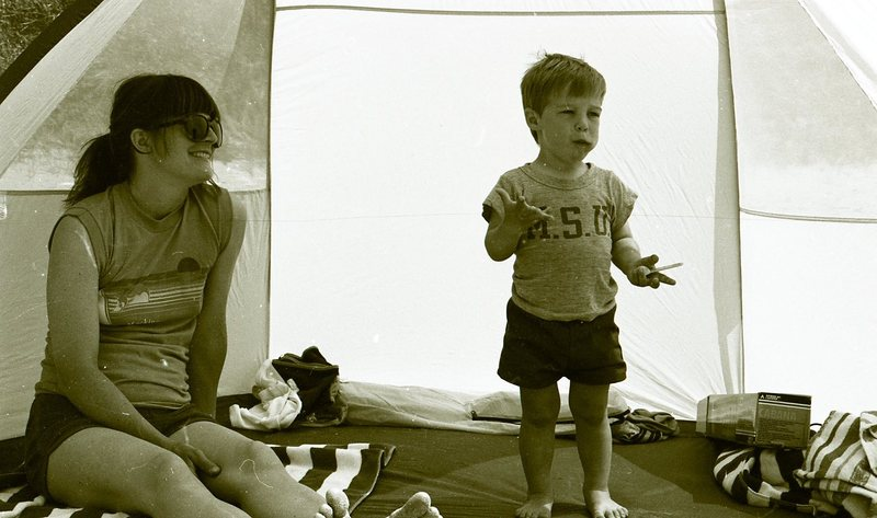 Go to Woman and little boy in tent item page