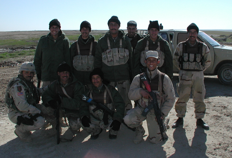 Go to SSG Ortiz posing with the Iraqi Army soldiers guarding the rear gate of FOB Q-West item page
