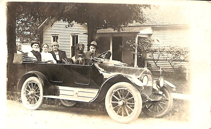 Go to Family of four and Fido inside a car, 1917 item page