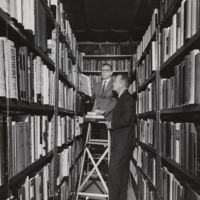 Go to Pink House. Library Director in the book stacks item page