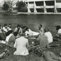 Go to Zumberge Pond. Students gathered on the grass item page
