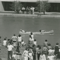 Go to Zumberge Pond. Students canoeing near crowd item page