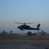 Go to AH-64 Apache hovering at an Apache refueling point at FOB Diamondback. (Mosul) item page