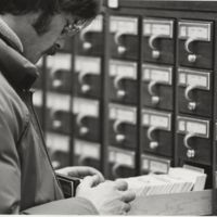 Go to Zumberge Library. Student using card catalog item page