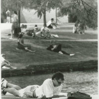 Go to Zumberge Pond. Students relaxing outside item page