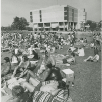Go to Zumberge Pond. Students relaxing outside Zumberge Library item page