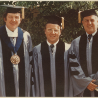 Go to President Lubbers with faculty during Commencement item page