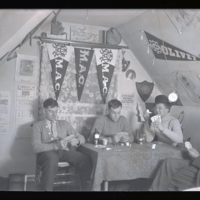 Go to Michigan. Michigan Agricultural College students playing cards in dorm item page
