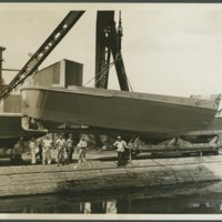 Go to Landing craft (LCVP) lowered into water by crane