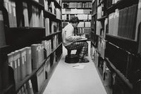Zumberge Library. Student using periodicals